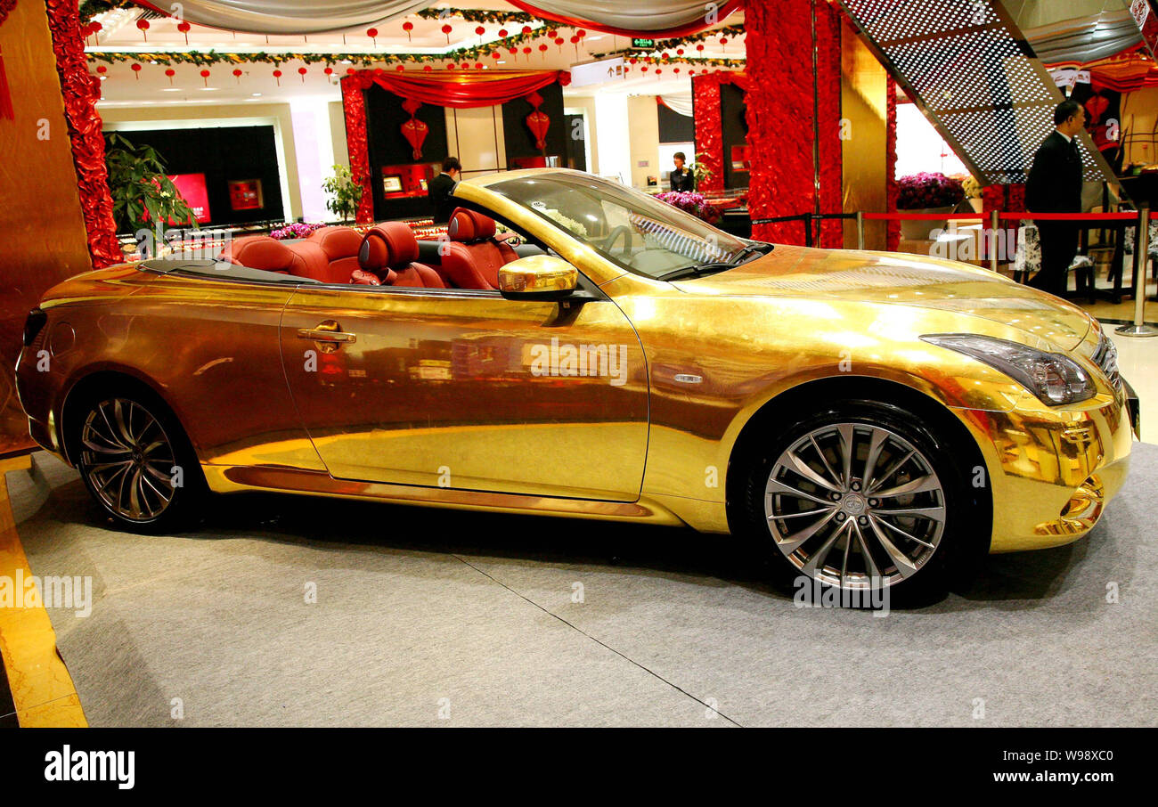 A gold Infiniti G37 Coupe Convertible is exhibited at a gold