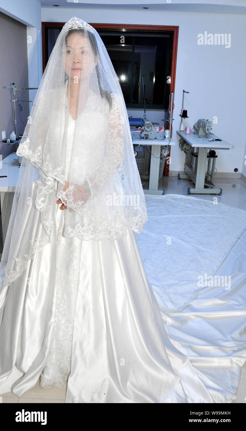Princess Kate Wedding Dress.A Model Wearing A Replica Of The Wedding Gown Of British Princess