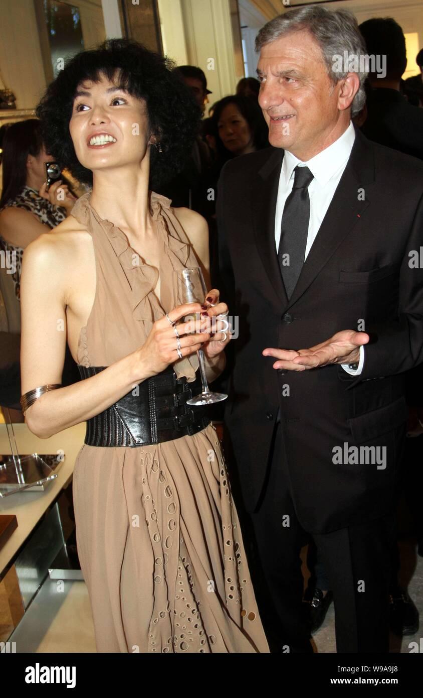 Hong Kong actress Maggie Cheung (L) and Dior CEO Sidney