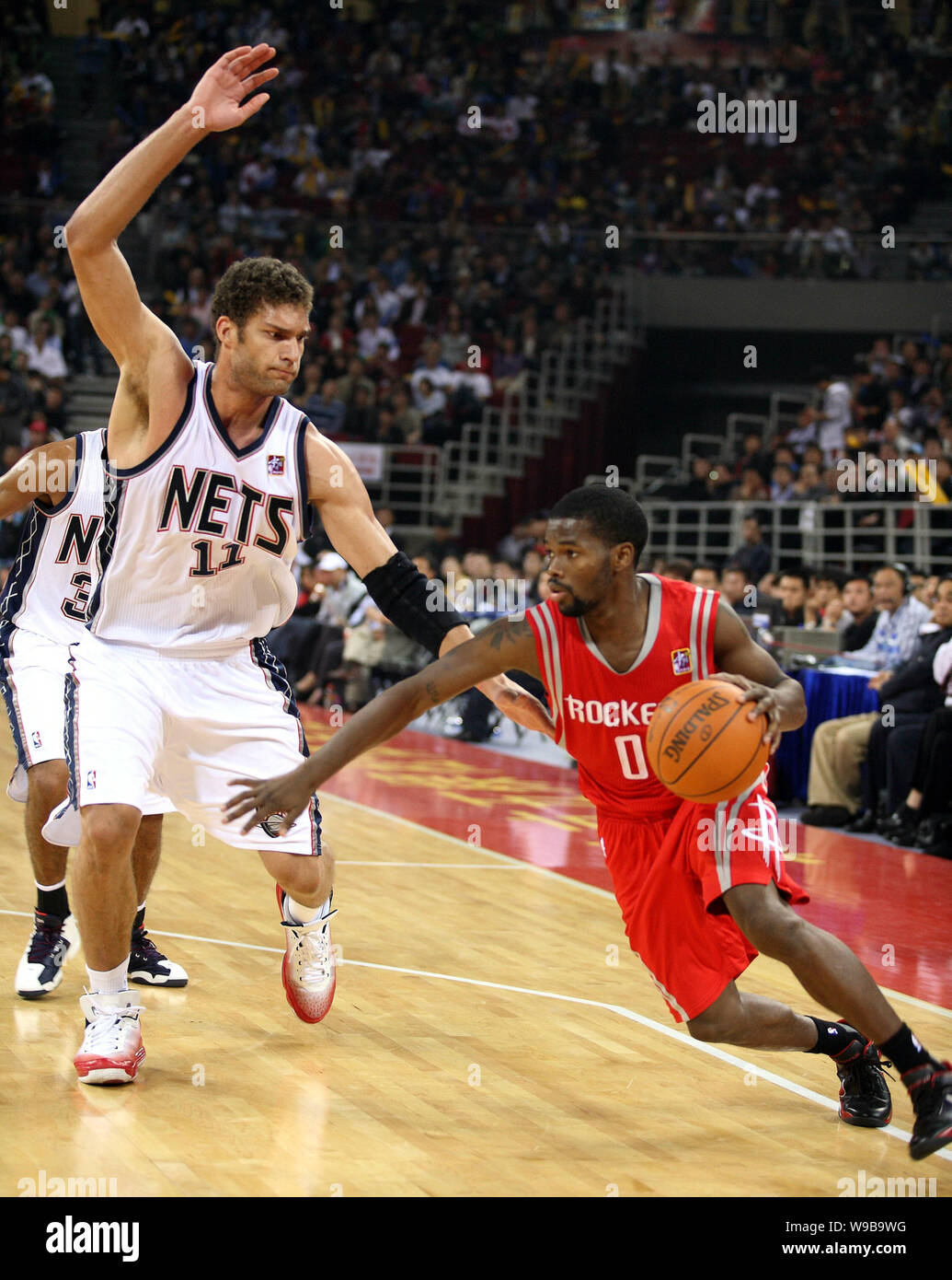best sneakers 8ad61 bb1a1 Aaron Brooks of the Houston Rockets, right, drives against ...