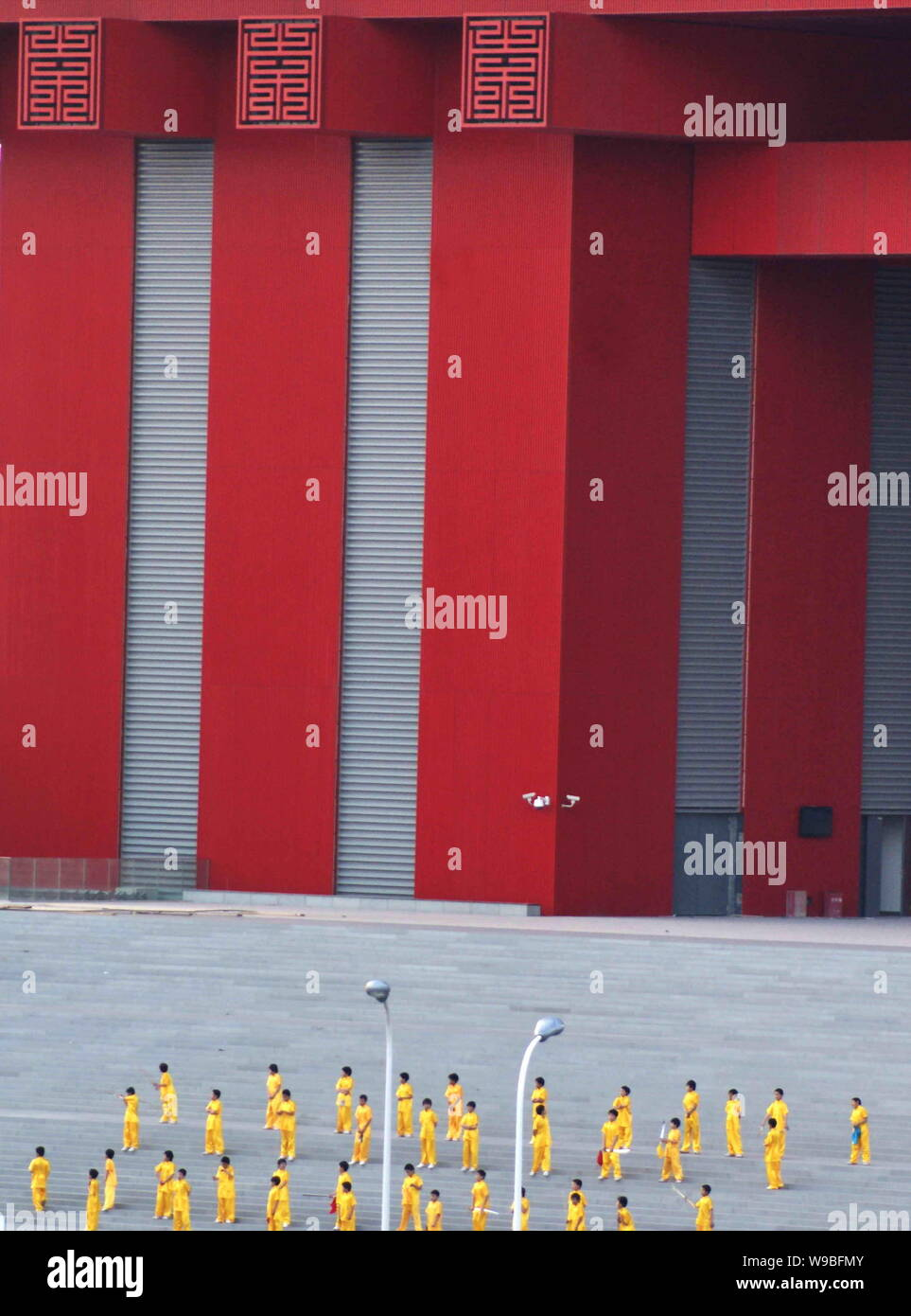 Chinese performers rehearse in front of the China Pavilion at the Expo site in Shanghai, China, March 18, 2010.   All vehicles entering Shanghai will Stock Photo
