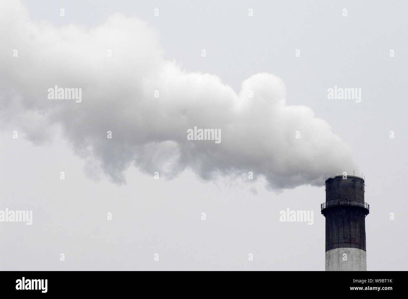 FILE--Smoke is seen emitted from a chimney of a heat power