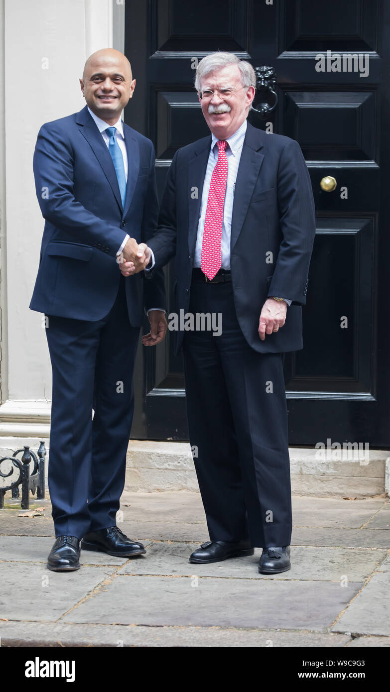 London, UK. 13th Aug, 2019. Chancellor of the Exchequer, Sajid Javid MP welcomes John Bolton, Trump's National Security Advisor on the doorsteps of Number 11 Downing Street. Credit: Keith Larby/Alamy Live News Stock Photo