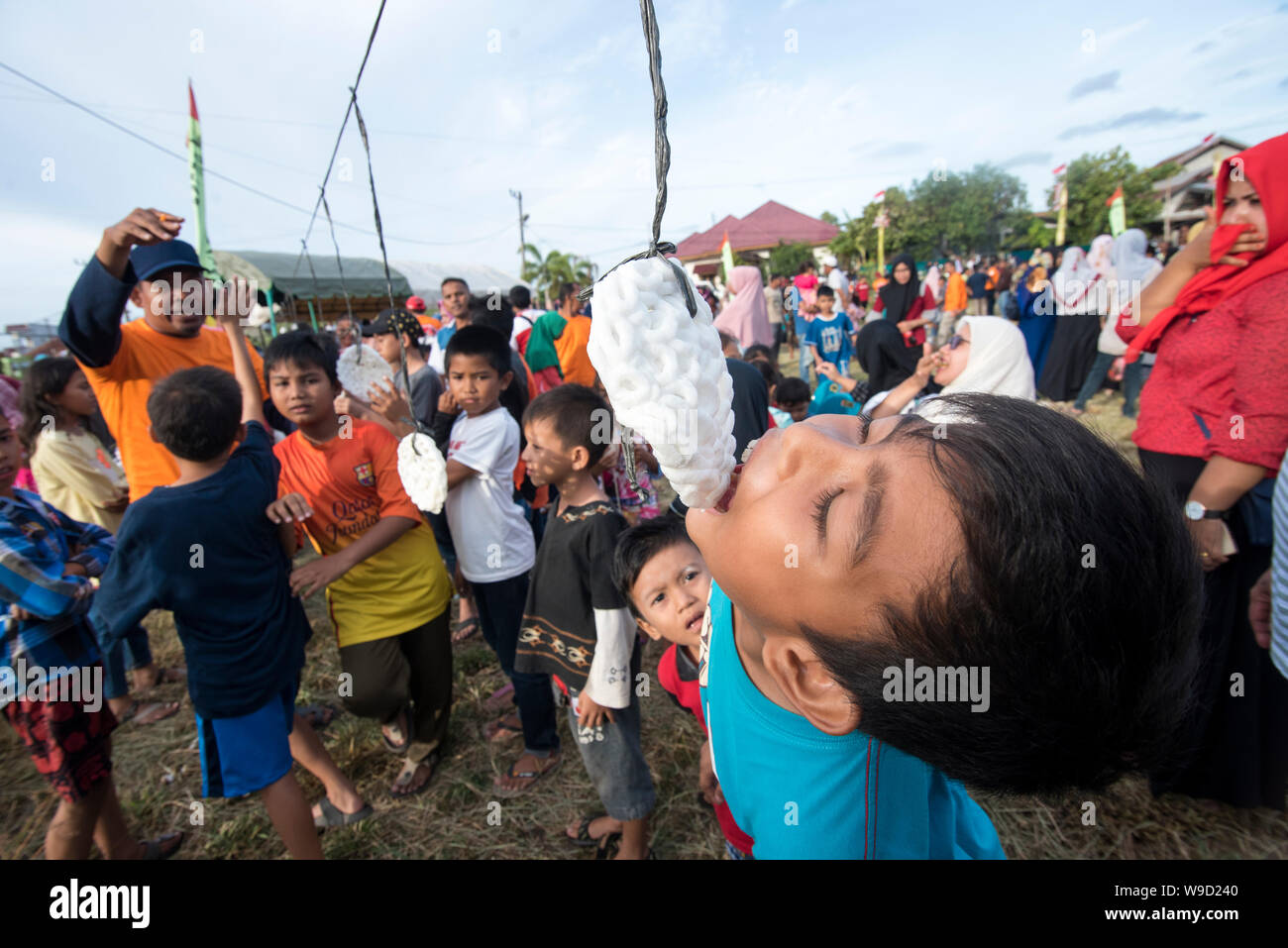 Banda Aceh, Indonesia - 17 August 2018: Participants try to eat crackers in the Crackers Eating Competition in Banda Aceh Welcoming Indonesia's Stock Photo