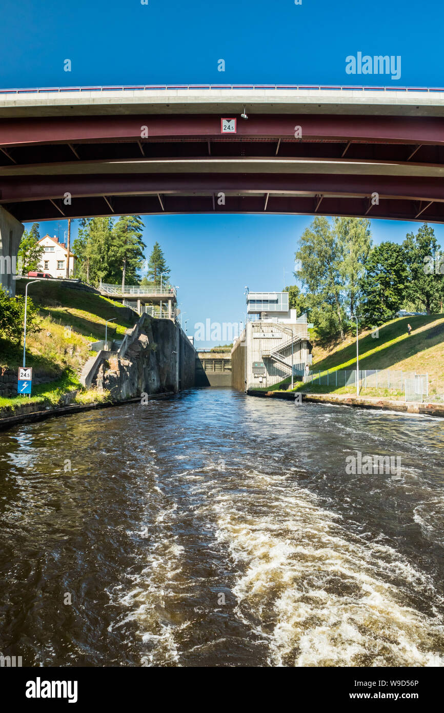 Lappeenranta, Finland - August 7, 2019: Lock and bridge on the Saimaa Canal at Malkia. View from water. Stock Photo