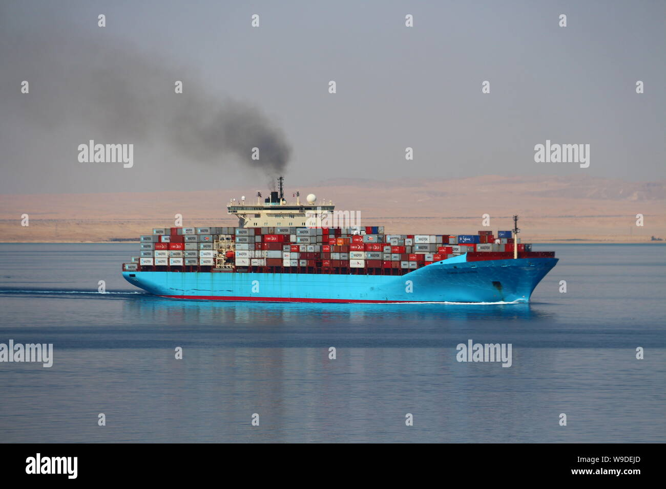 Container ship Maersk Karlskrona departing the Suez Canal and proceeding into the Red Sea. Stock Photo