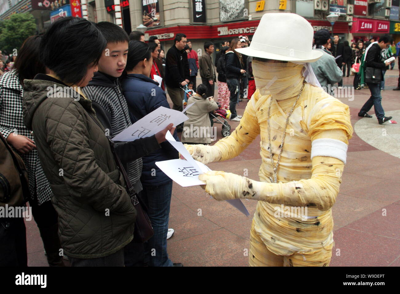 A Chinese University Graduate Dressed Like A Mummy
