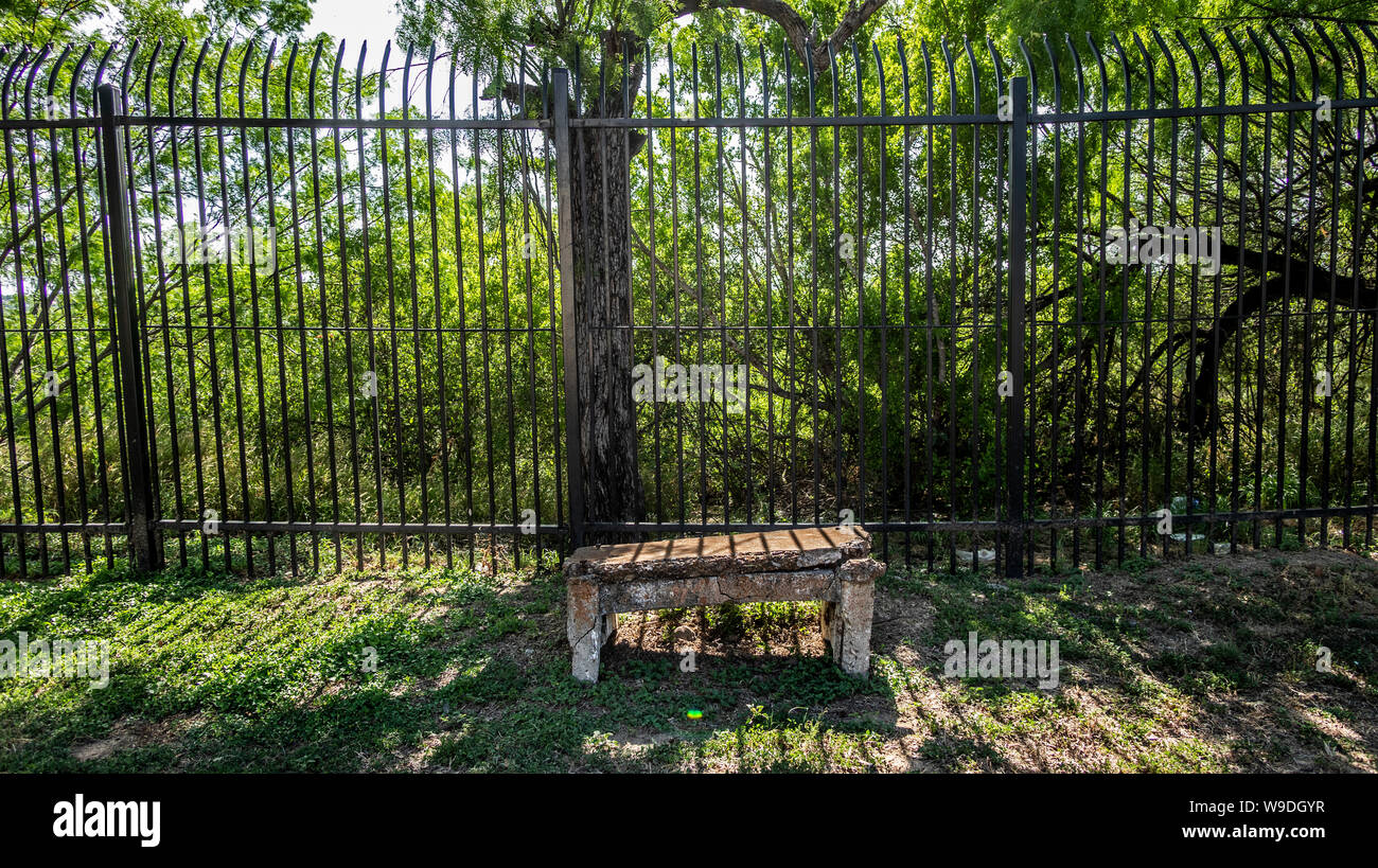 A portion of the border fence along the edge of Laredo Community College's campus in Laredo, Texas Stock Photo