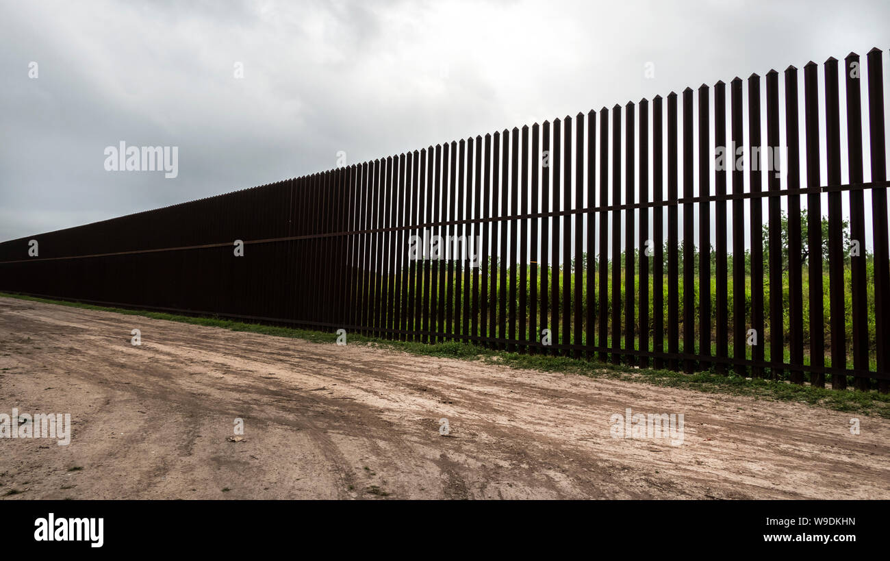 A portion of the high steel border wall, Brownsville, Texas, USA. Stock Photo