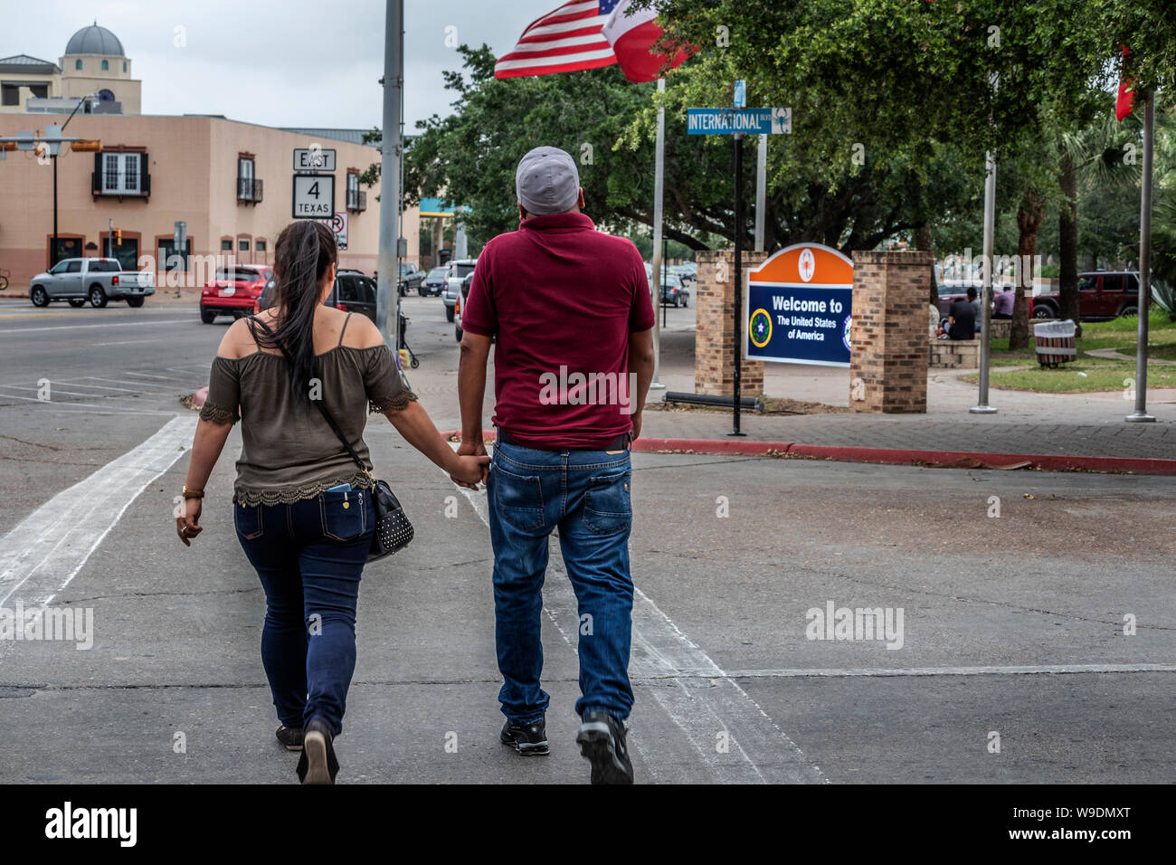 Mexican couple entering into the USA. Welcome to The United States of America sign. Brownsville, Texas, USA Stock Photo
