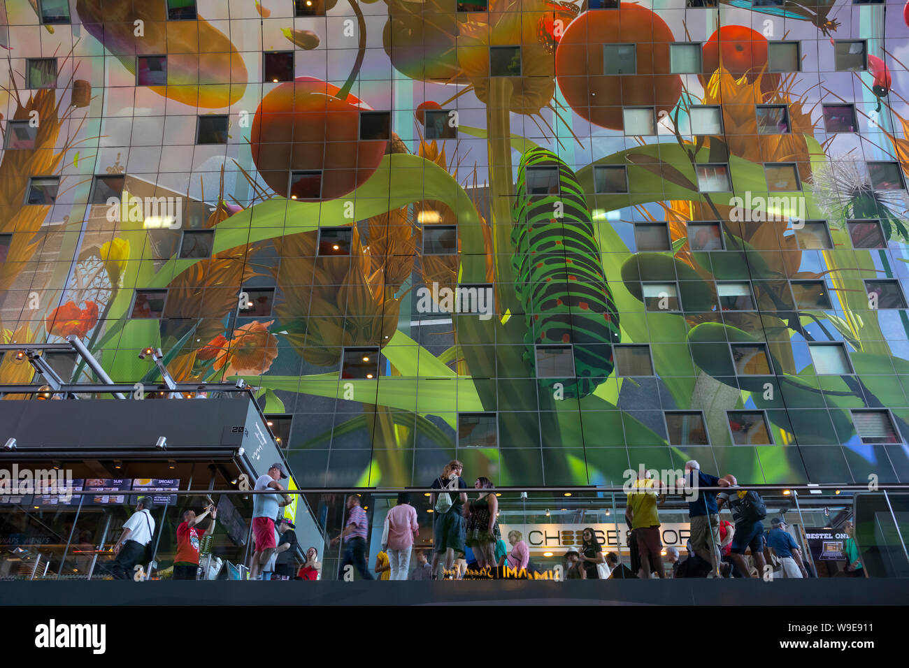 Rotterdam, Holland - July 30, 2019: Artwork at the wall of the Markthal, a residential and office building with a market hall underneath Stock Photo