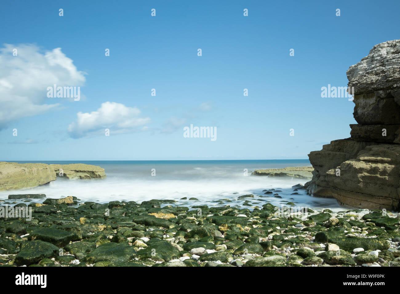 The rocky shore at Thornwick Nab near Flamborough Head on the East Yorkshire coast Stock Photo
