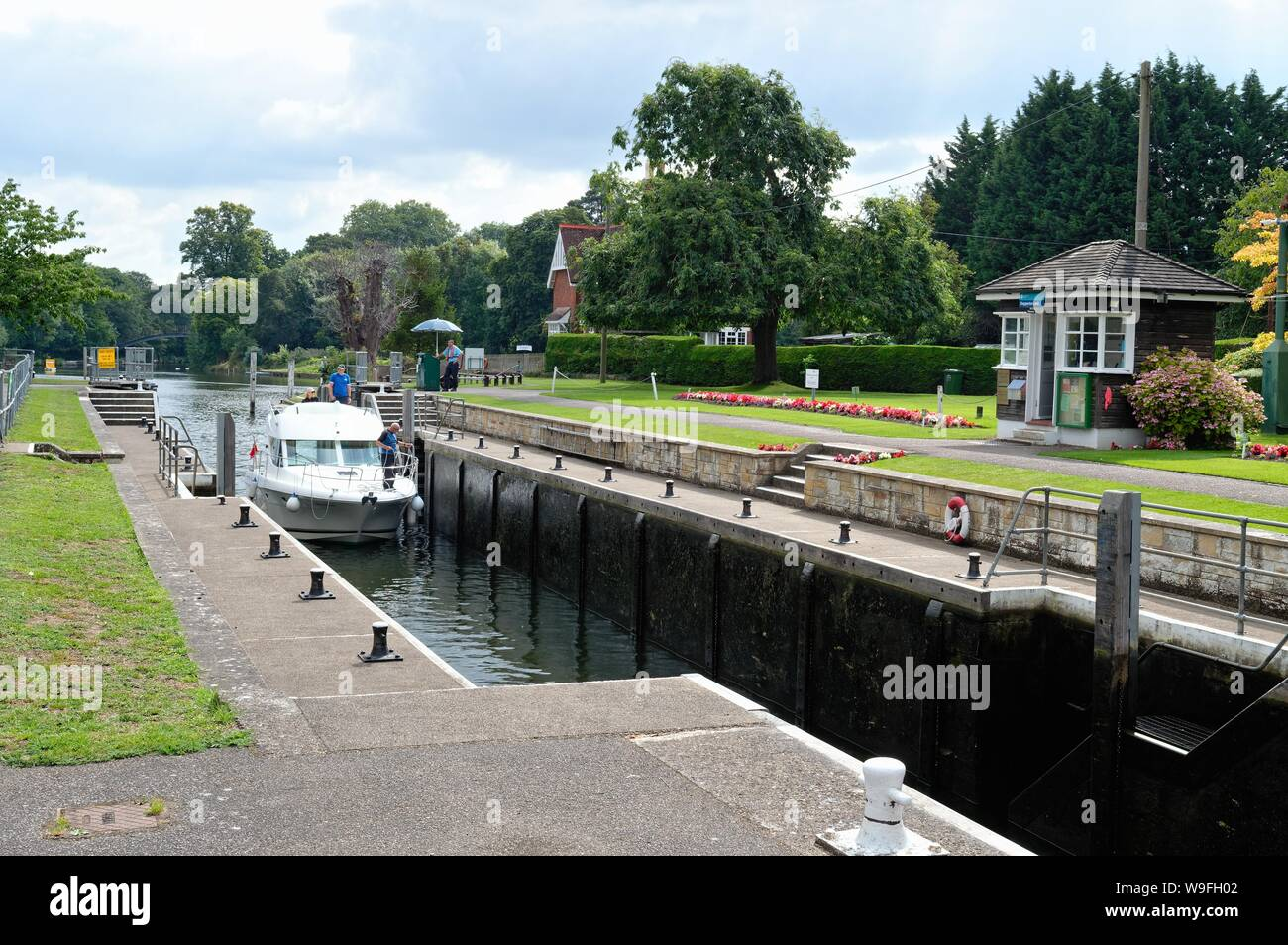 A private leisure river cruiser passing through Shepperton lock on a summers day, Surrey England UK Stock Photo