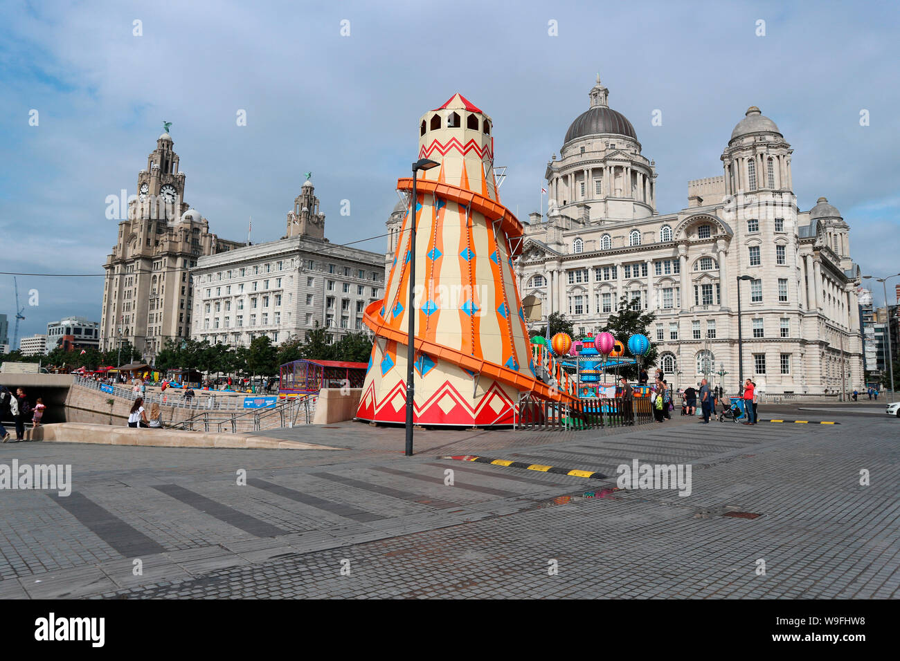 Slide in front of Liverpool`s three Graces Stock Photo