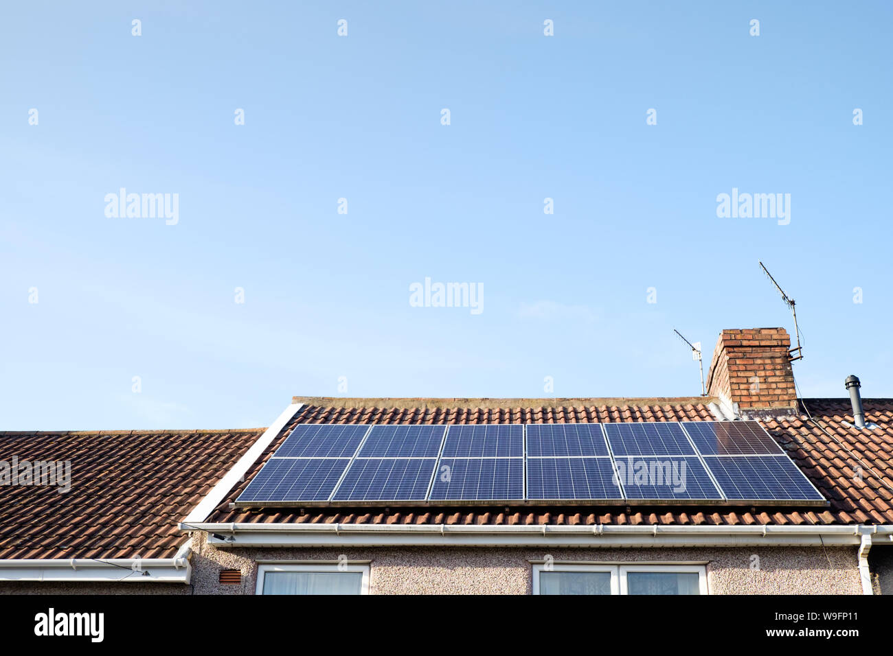 Rooftop solar panels generating renewable energy on a sunny day in Bristol, England, UK. Stock Photo