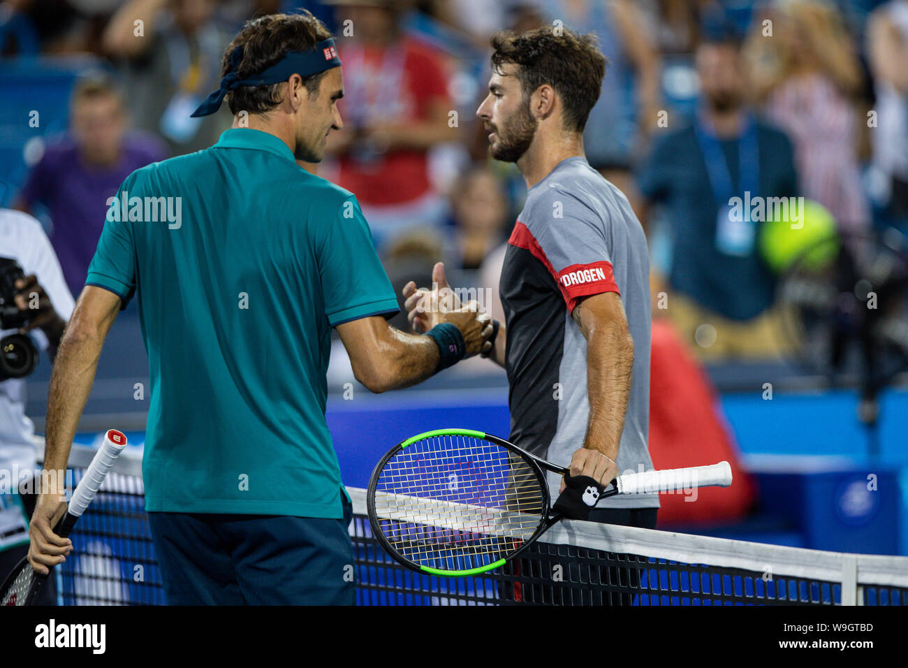 Mason, Ohio, USA. 13th Aug, 2019. Roger Federer, (SUI) and Juan Ignacio Londero (ARG) meet at the net after Federer won their match at Tuesday's round of the Western and Southern Open at the Lindner Family Tennis Center, Mason, Oh. Credit: Scott Stuart/ZUMA Wire/Alamy Live News Stock Photo