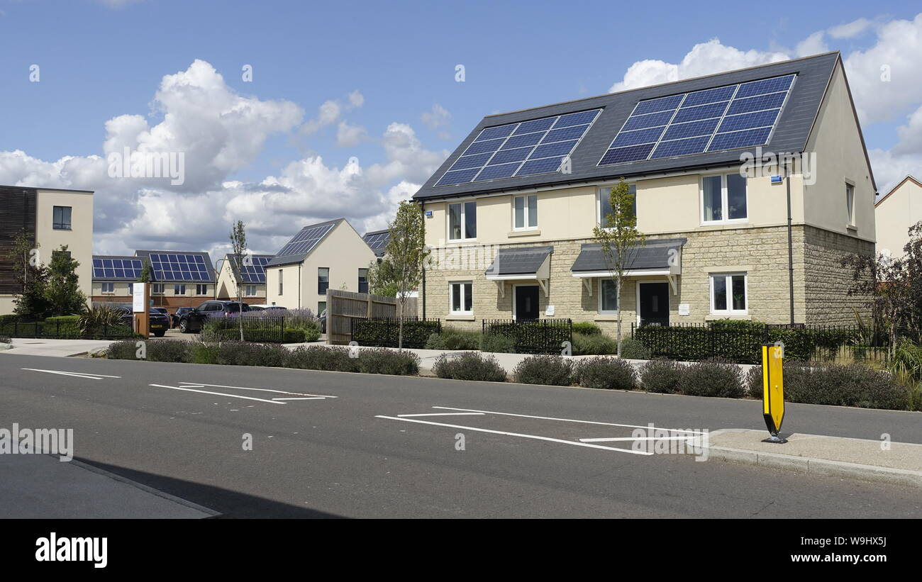 New contemporary sustainable low energy housing development with solar panels, rainwater harvesting, triple glazing, and attractive community spaces Stock Photo
