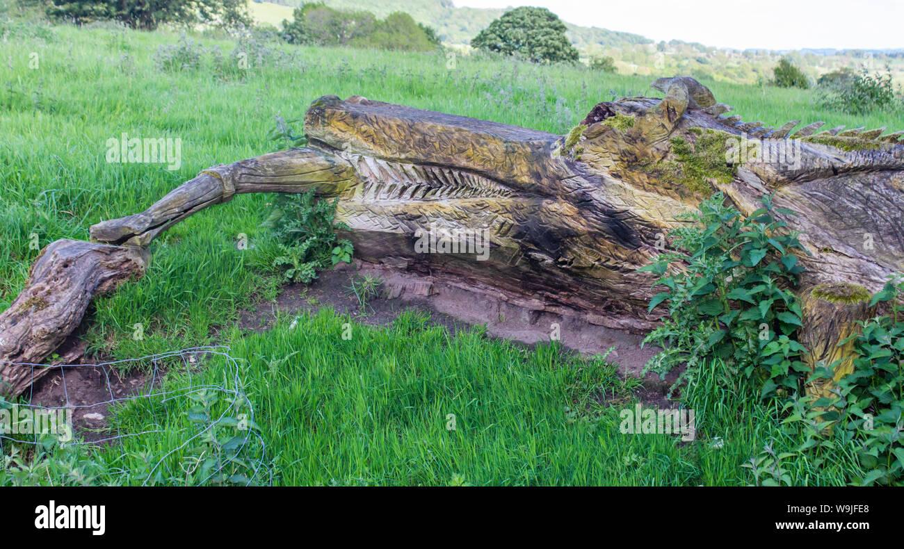 Castle Bolton village, near Bolton Castle, Wensleydale, North Yorkshire, England. Strange wooden carving of a crocodile Stock Photo