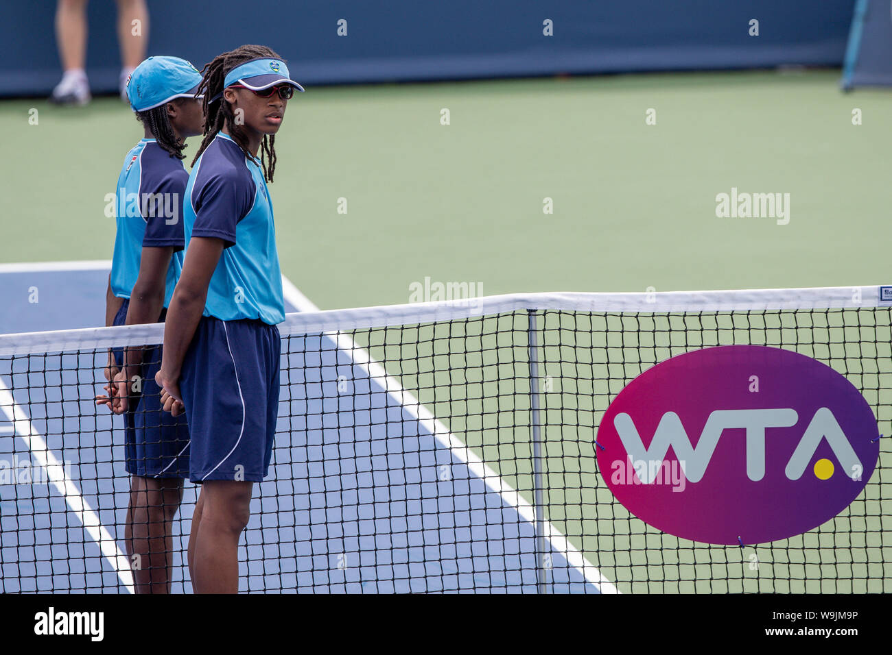 Mason, Ohio, USA. 13th Aug, 2019. Ball boys wait for the start of their match at Tuesday's round of the Western and Southern Open at the Lindner Family Tennis Center, Mason, Oh. Credit: Scott Stuart/ZUMA Wire/Alamy Live News Stock Photo