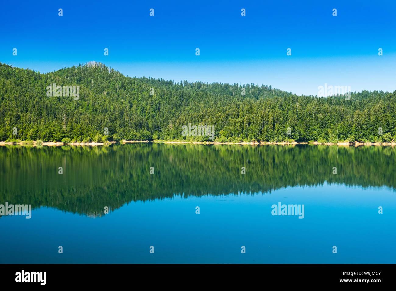 Croatia, beautiful blue lake in Gorski kotar, Lokve, Croatia, with Risnjak mountain in background, reflection in watter Stock Photo