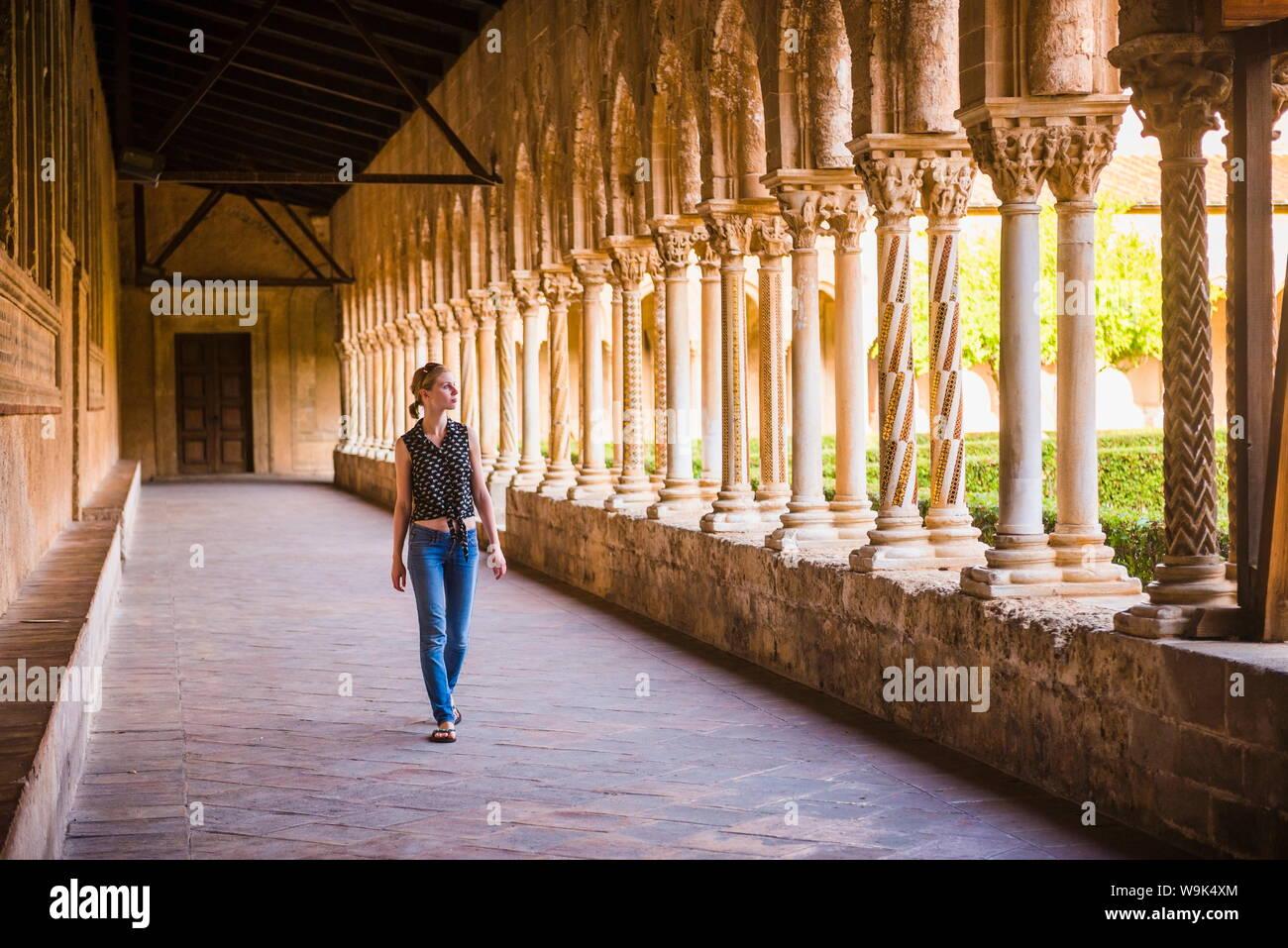 Tourist at Monreale Cathedral (Duomo di Monreale) in courtyard gardens, Monreale, near Palermo, Sicily, Italy, Europe Stock Photo