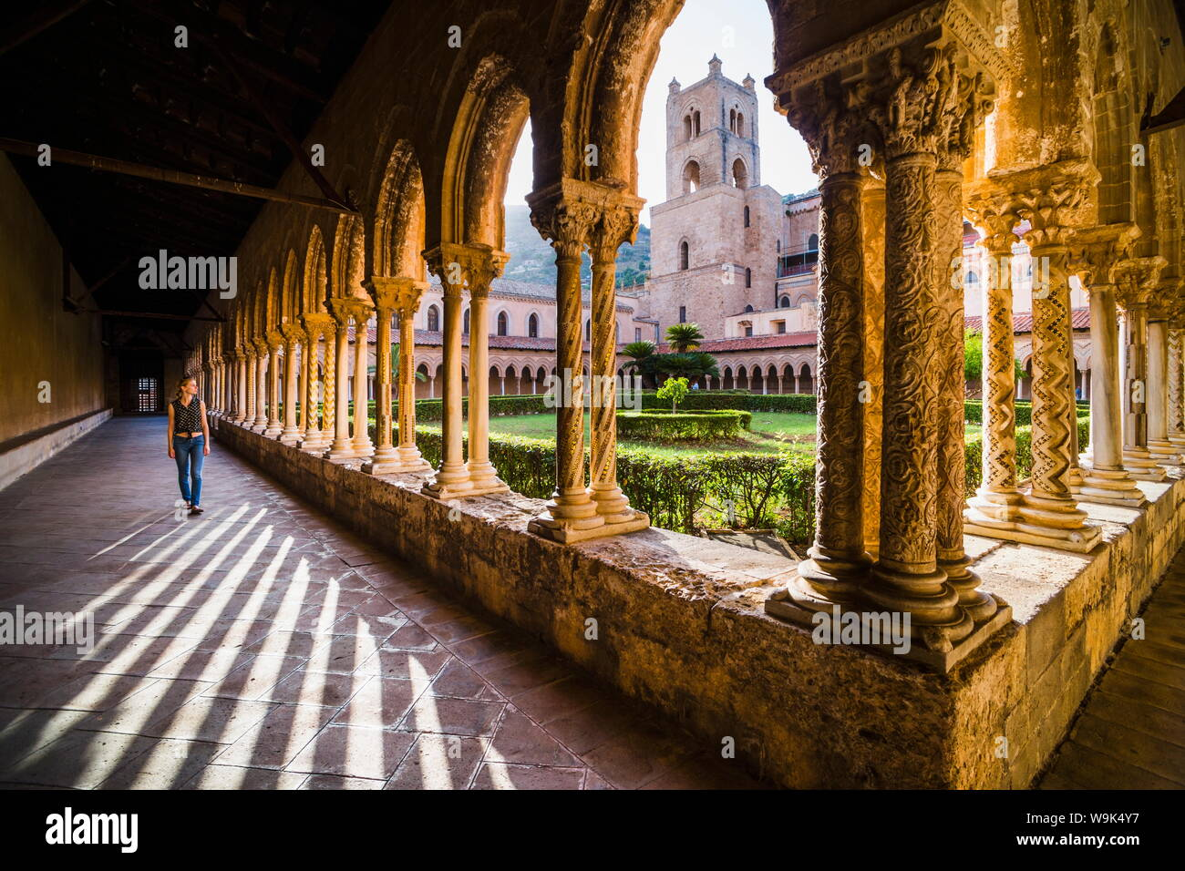 Tourist at Duomo di Monreale (Monreale Cathedral) in the courtyard gardens, Monreale, near Palermo, Sicily, Italy, Europe Stock Photo