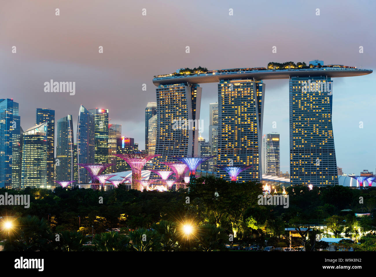 Gardens by the Bay, Supertree Grove and Marina Bay Sands Hotel and Casino, Singapore, Southeast Asia, Asia Stock Photo