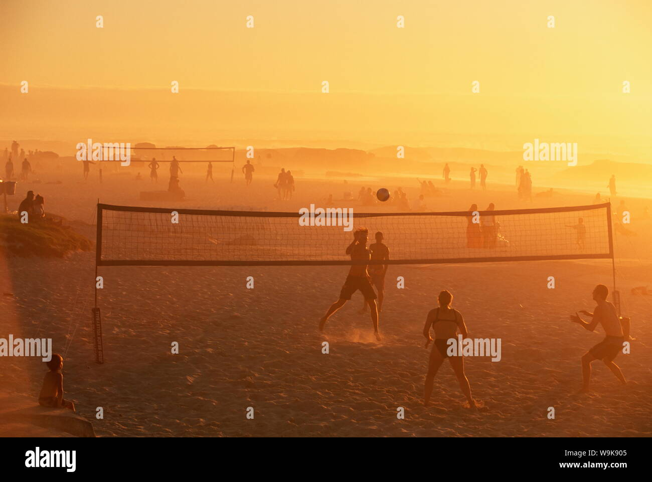 Beach volleyball game, late afternoon, Camps Bay, Cape Town, South Africa, Africa Stock Photo