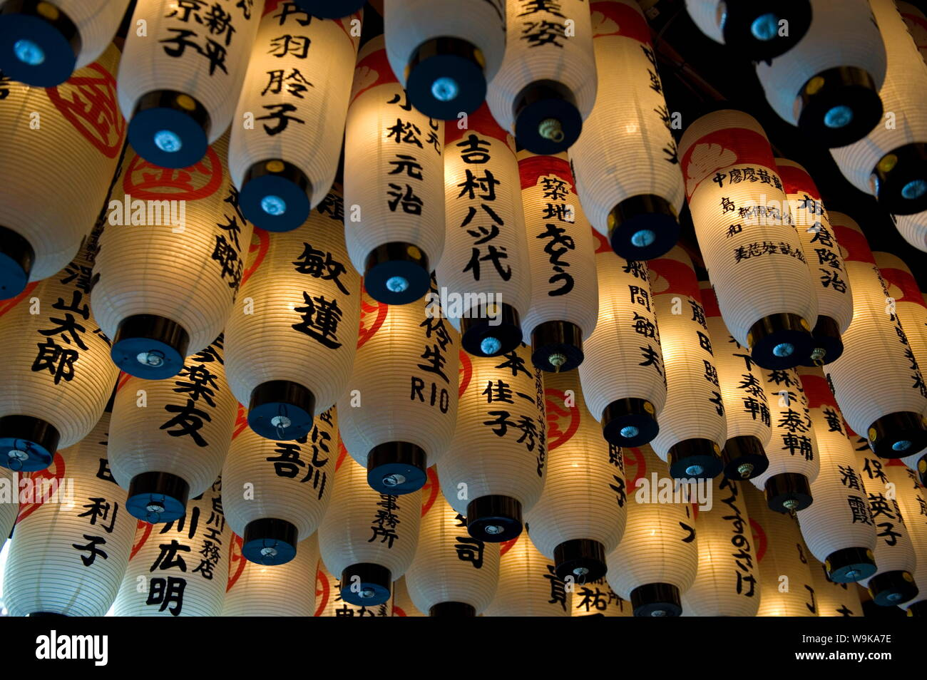 Lanterns with donors names hanging from the ceiling at Hozenji Temple in Namba, Osaka, Japan Stock Photo