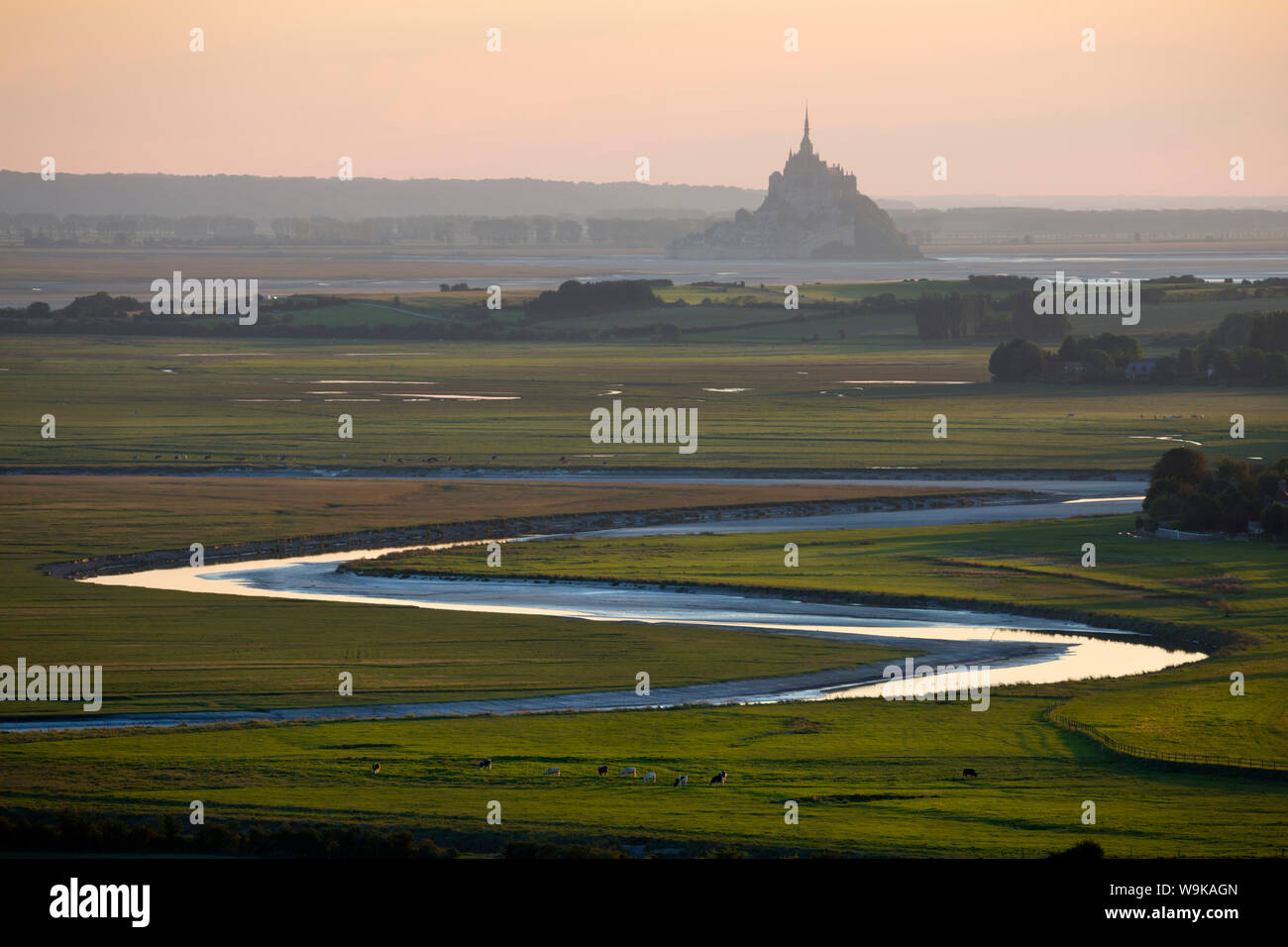 View over meandering river to Bay of Mont Saint-Michel, UNESCO World Heritage Site, from Jardin des Plantes viewpoint, Avranches, Normandy, France Stock Photo