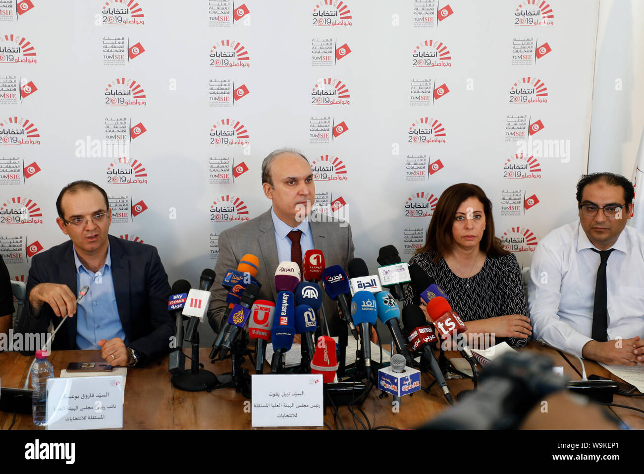 Tunis, Tunisia. 14th Aug, 2019. The head of Tunisia's Independent High Authority for elections (ISIE) Nabil Baffoun (C) speaks during a press conference to announce the approved candidacies for the upcoming presidential election. Twenty-six candidacies to the Tunisian presidential election of September 15 have been validated and 71 rejected. Credit: Khaled Nasraoui/dpa/Alamy Live News Stock Photo