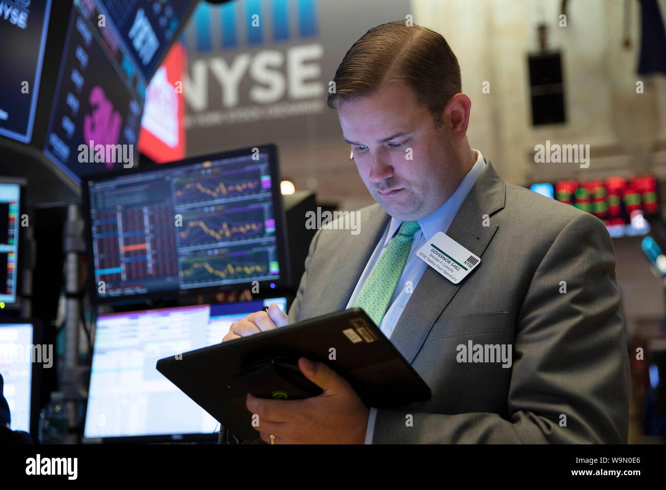 New York, USA. 14th Aug, 2019. A trader works at the New York Stock Exchange in New York, the United States, on Aug. 14, 2019. U.S. stocks closed remarkably lower on Wednesday, as persisting fears over an imminent recession struck a blow to the already-dampened investor sentiment. The Dow plunged 800.49 points, or 3.05 percent to 25,479.42, marking the largest daily decline of the year so far. The S&P 500 decreased 85.72 points, or 2.93 percent, to 2,840.60. Credit: Xinhua/Alamy Live News Credit: Xinhua/Alamy Live News Stock Photo