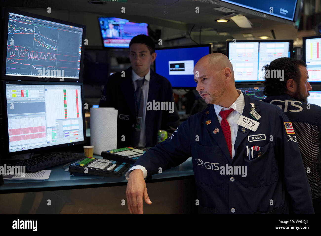 New York, USA. 14th Aug, 2019. Traders work at the New York Stock Exchange in New York, the United States, on Aug. 14, 2019. U.S. stocks closed remarkably lower on Wednesday, as persisting fears over an imminent recession struck a blow to the already-dampened investor sentiment. The Dow plunged 800.49 points, or 3.05 percent to 25,479.42, marking the largest daily decline of the year so far. The S&P 500 decreased 85.72 points, or 2.93 percent, to 2,840.60. Credit: Xinhua/Alamy Live News Credit: Xinhua/Alamy Live News Stock Photo