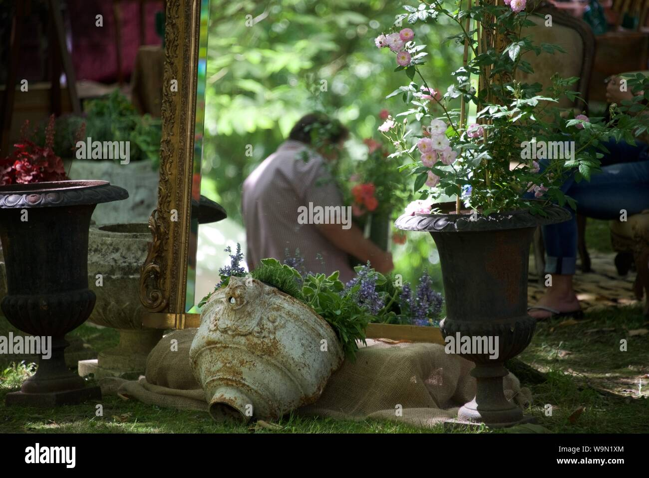 An image that sums up the annual open day held at the Château de Humeroeuille where antiques and nursery plants and flowers are sold side-by-side Stock Photo