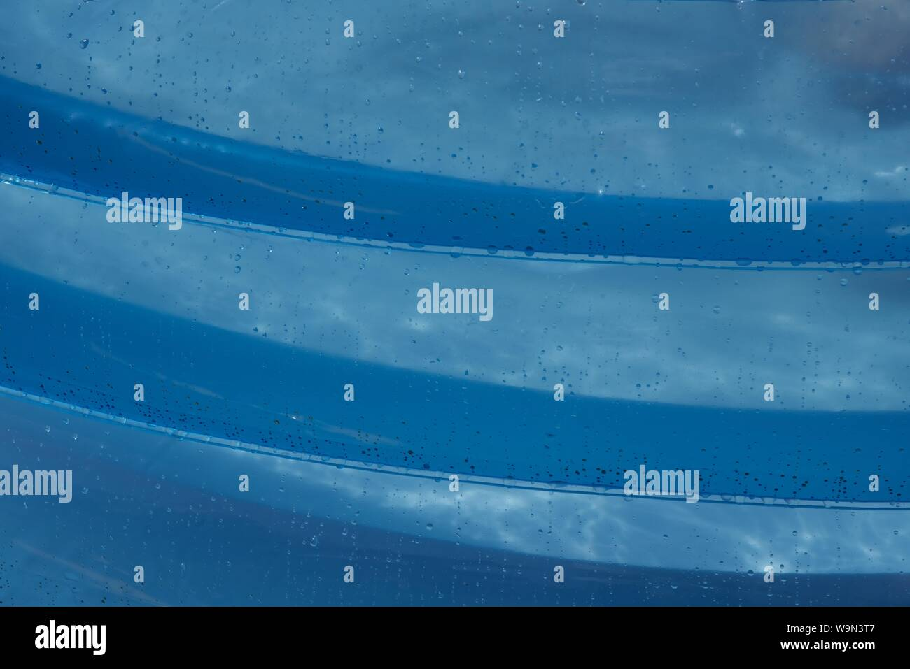 Inflatable paddling pool: beads of water on an inflatable paddling pool Stock Photo