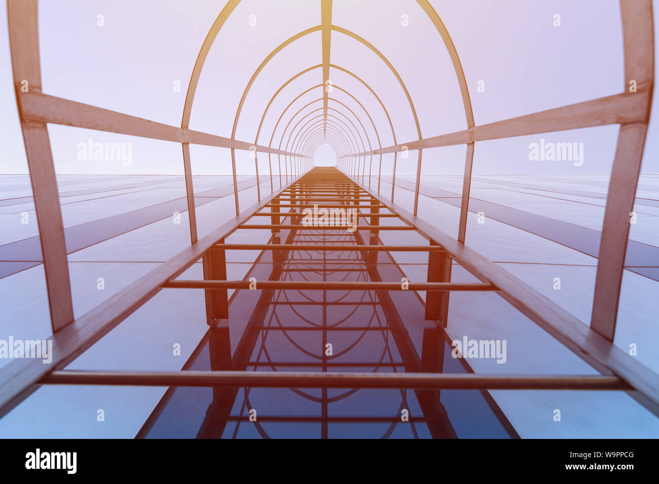 Stairway to Heaven concept. Fire escape staircase of modern shopping center. Emergency fire exit. Bottom view Stock Photo