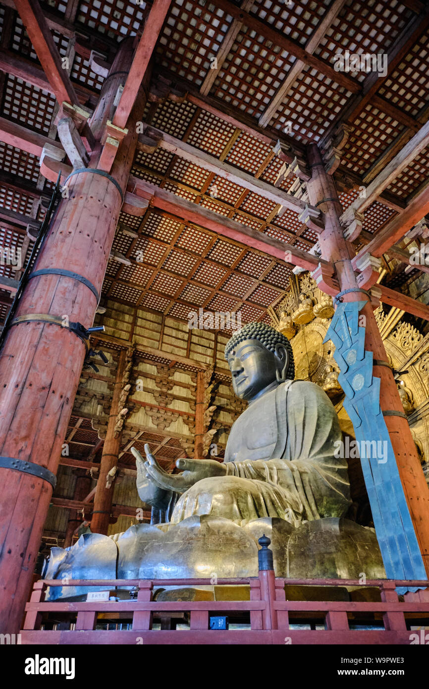 The interior of the ancient daibutsuden at Todaiji, Nara houses the worlds largest statue of Buddha cast in bronze. Stock Photo