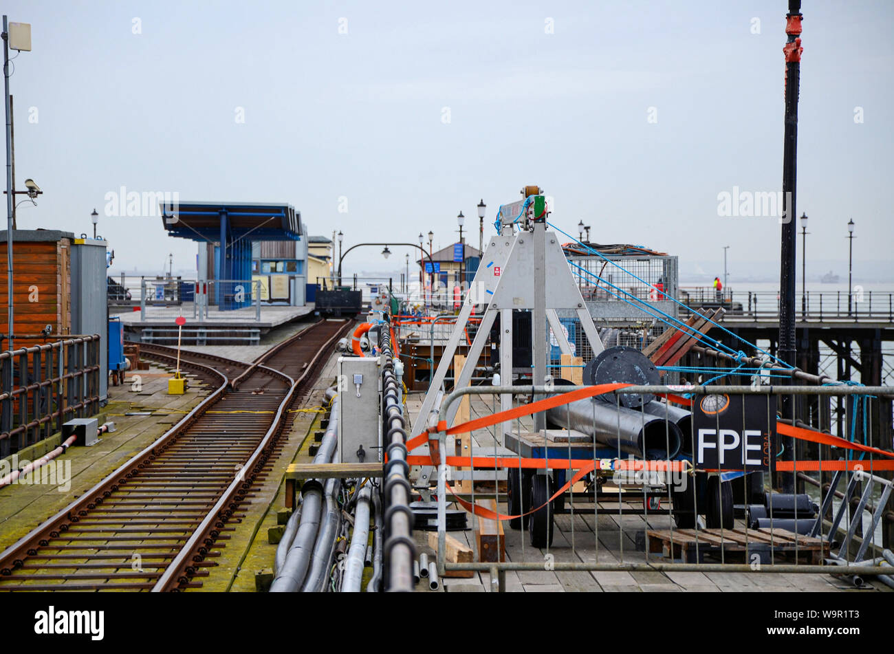 Repair work underway on Southend Pier after it was hit by a barge in bad weather. Construction. Repairs. Damaged. Closed. Space for copy Stock Photo