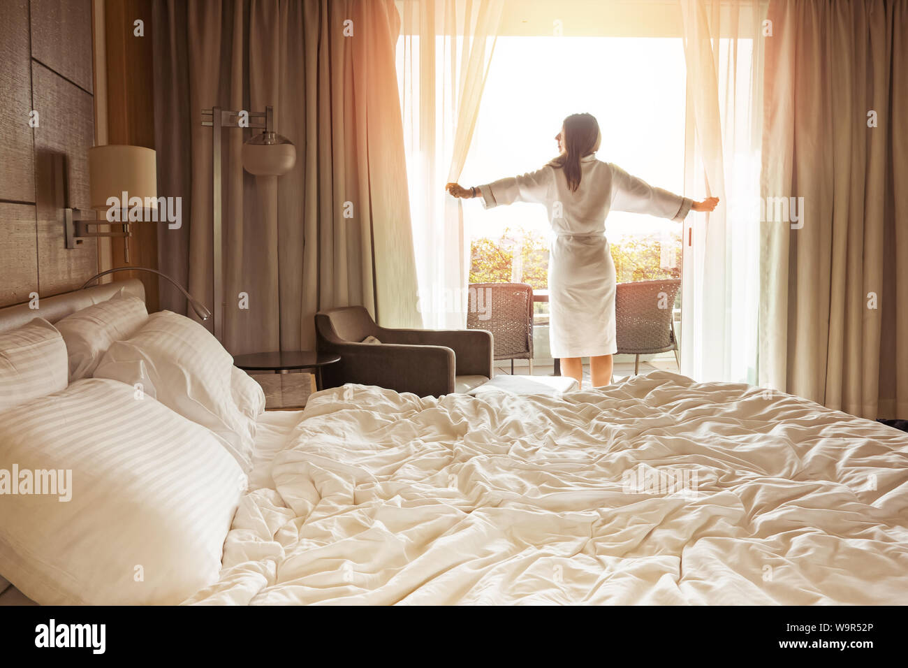 Woman Opening Hotel Curtains Stock Photos & Woman Opening