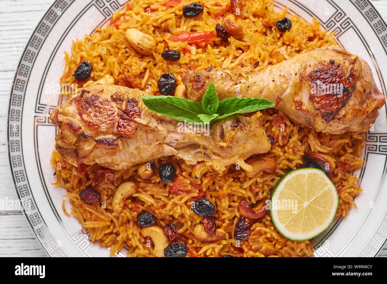Chicken Kabsa Or Chicken Biryani At White Wooden Background Kabsa Is Traditional Saudi Arabian Cuisine Dish Kabsa Cooks With Basmati Rice Chicken Stock Photo Alamy