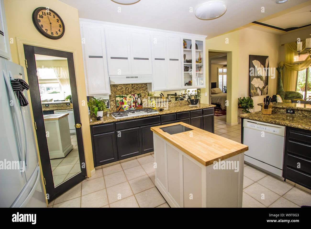 Modern Kitchen With Pantry Granite Counters And Butcher Block Island Stock Photo Alamy