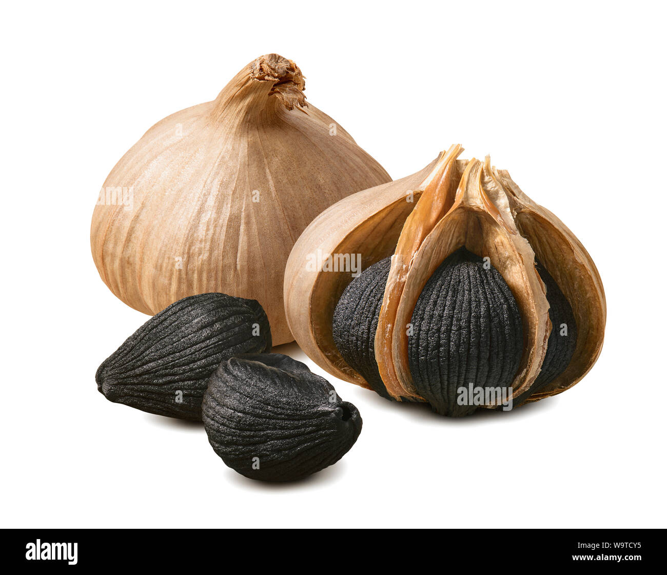 Black garlic bulbs and cloves isolated on white background. Package design element with clipping path Stock Photo