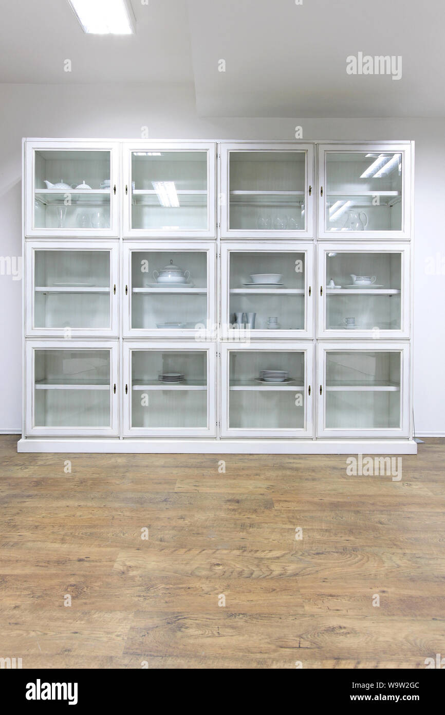White Cupboard Display Cabinet With Glass Doors Stock Photo
