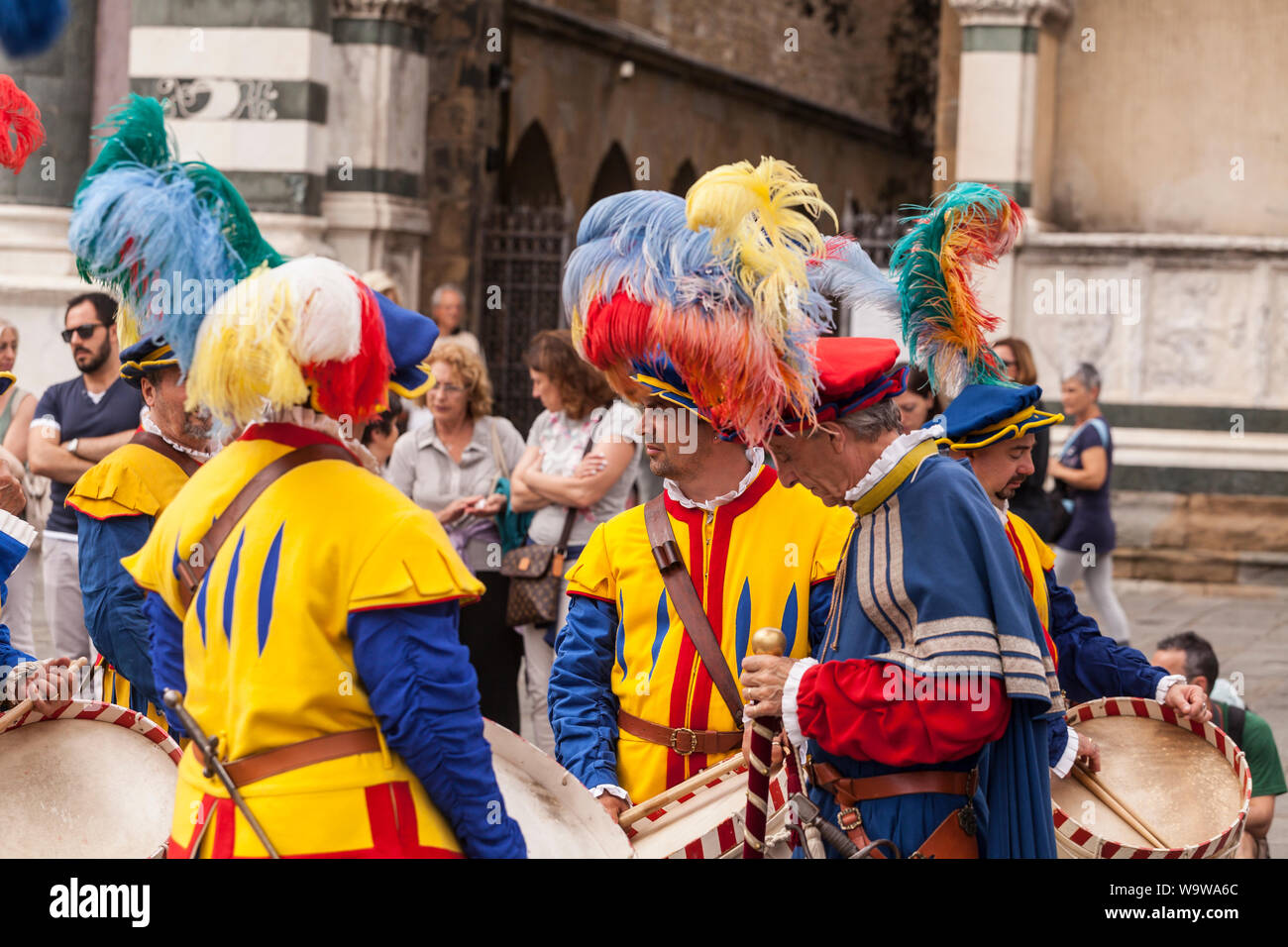 Traditional costumes at the Calcio Storico parade in Florence, Italy. Also known as Calcio Fiorentino the game is thought to be an early form of moder Stock Photo