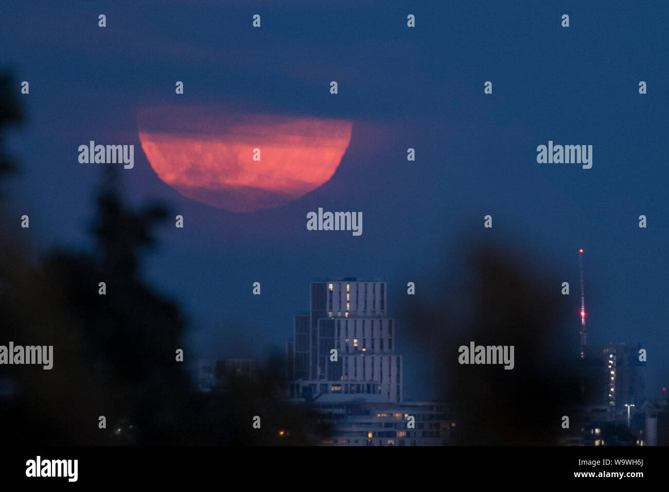 London, UK  15 August 2019  A full moon rises over Wembley