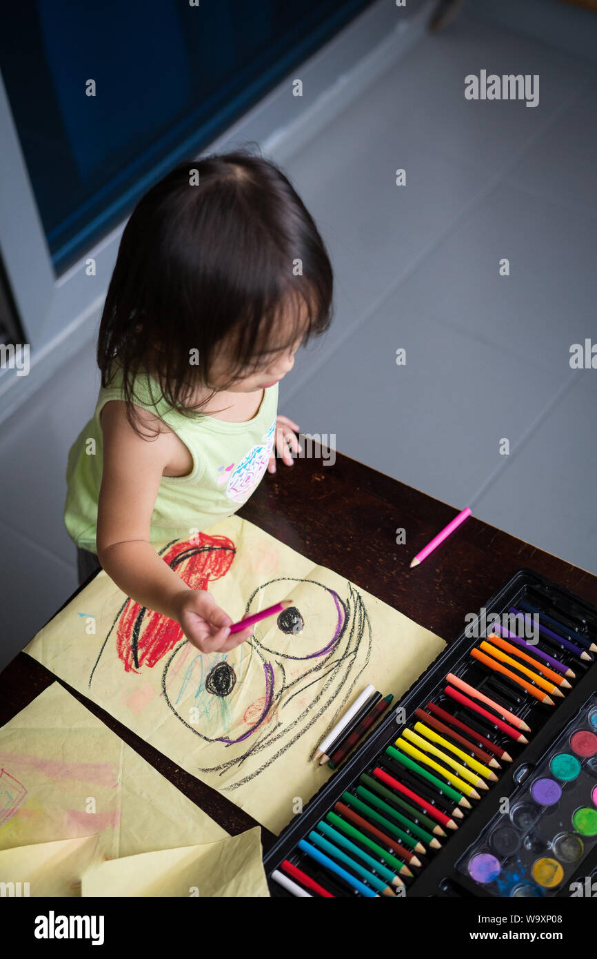 Cute Little Girl Is Coloring Pages And Painting Children