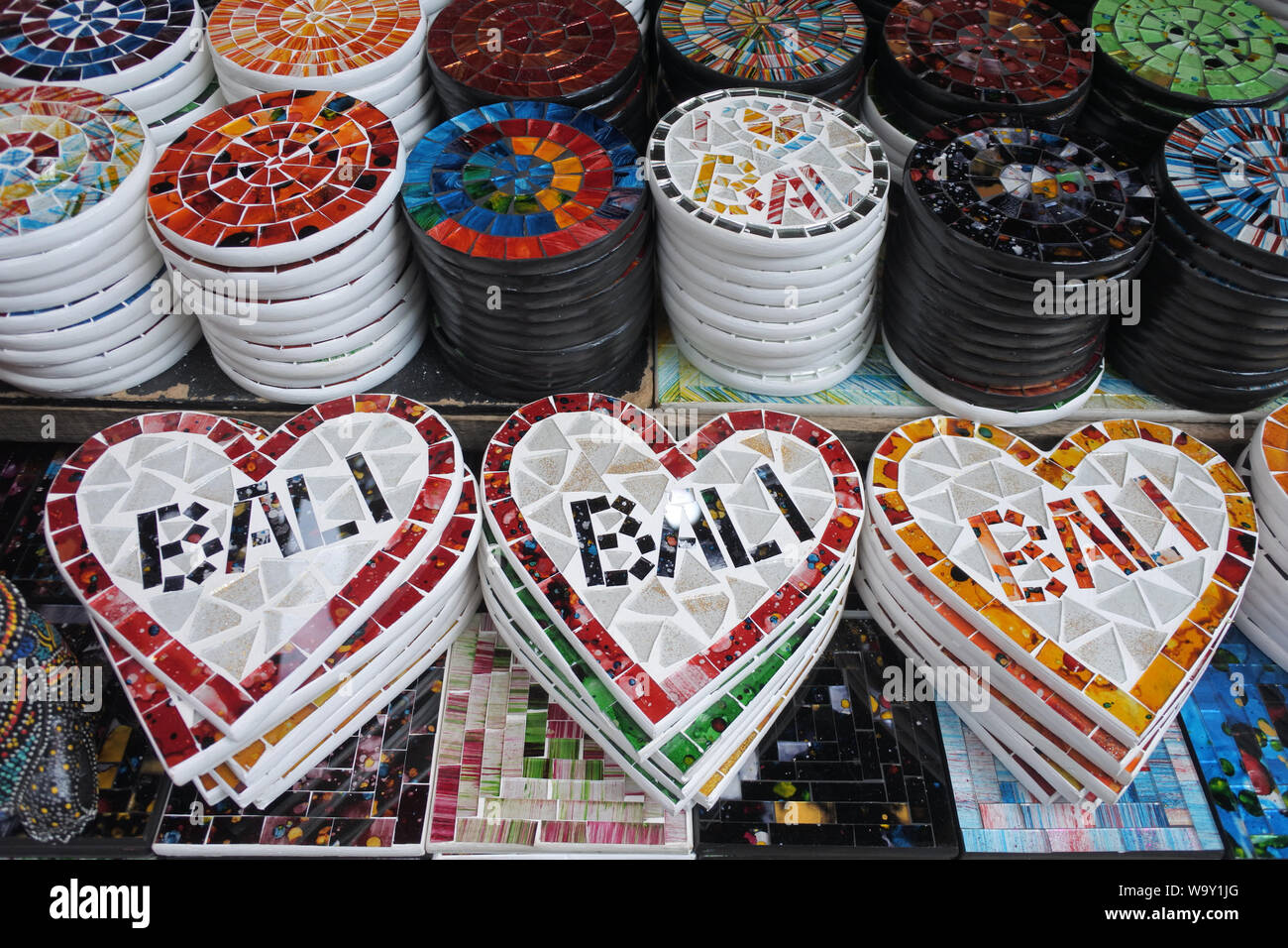 Placemats in a shap of a heart with the name Bali in souvenirs shop in Ubud market Bali Indonesia. Stock Photo