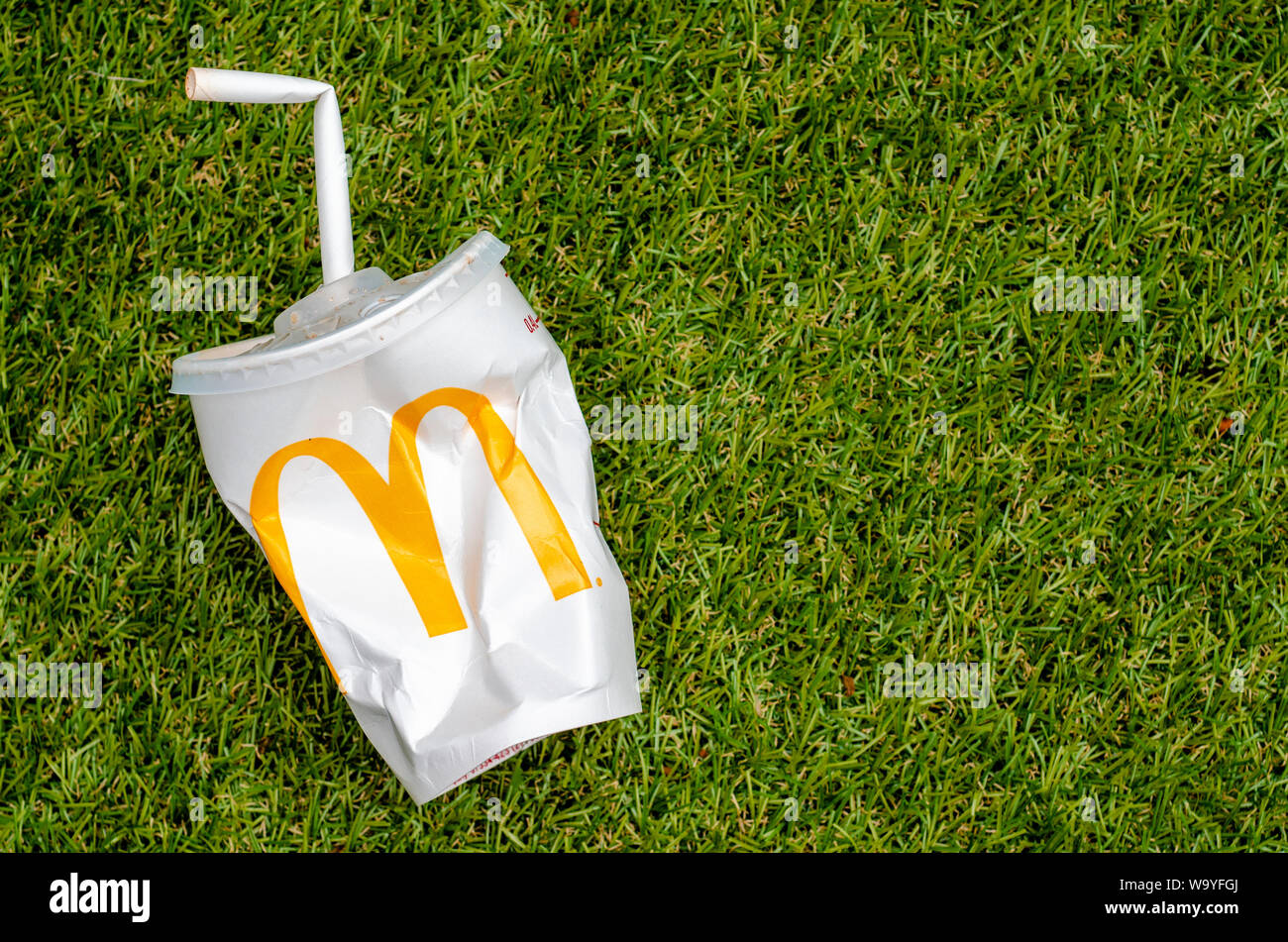 McDonald's Empty Cola Cup with Paper Straw, McDonald's is the world's largest chain of hamburger fast food restaurants. Stock Photo