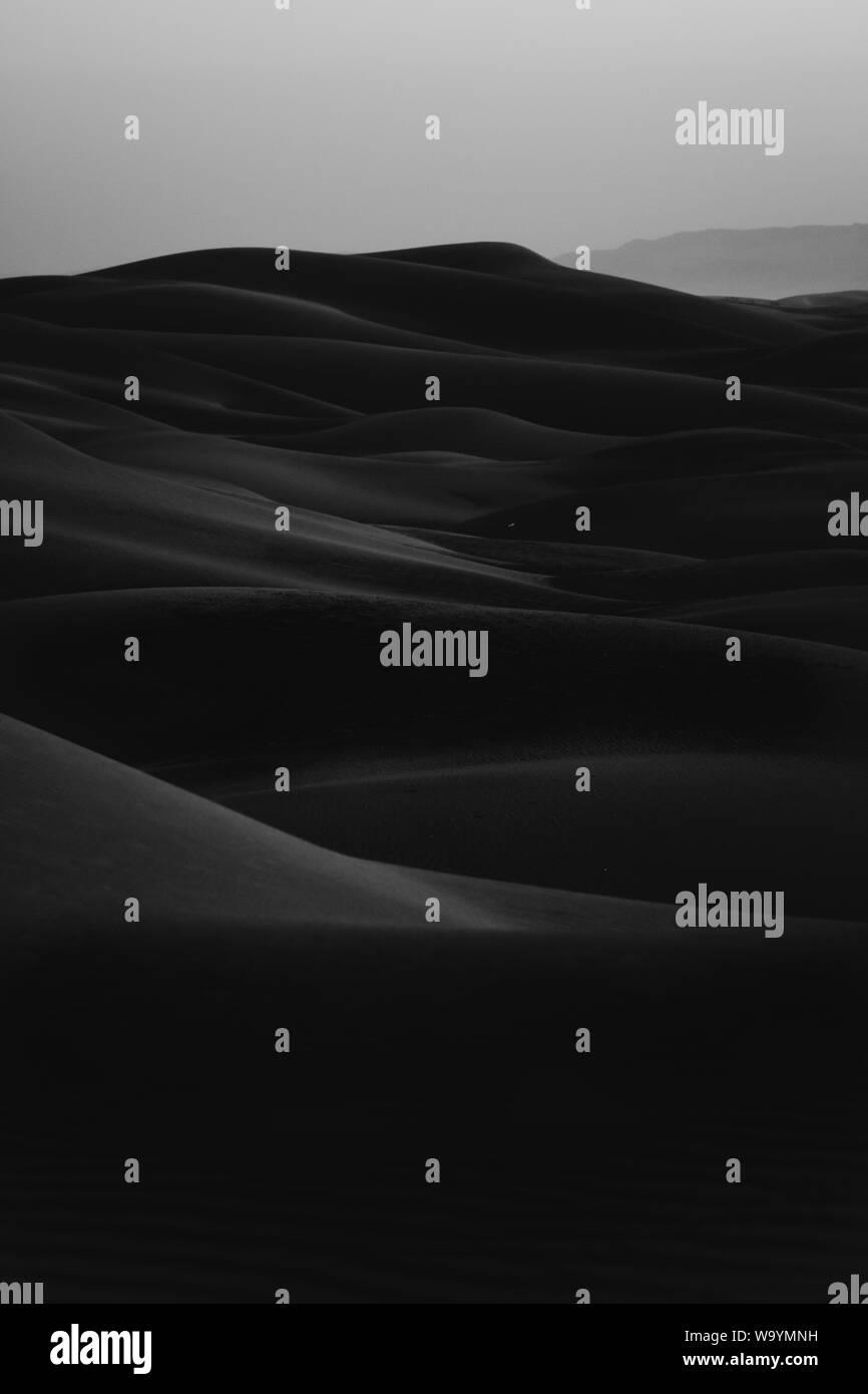 A vertical black and white shot of erg desert Stock Photo
