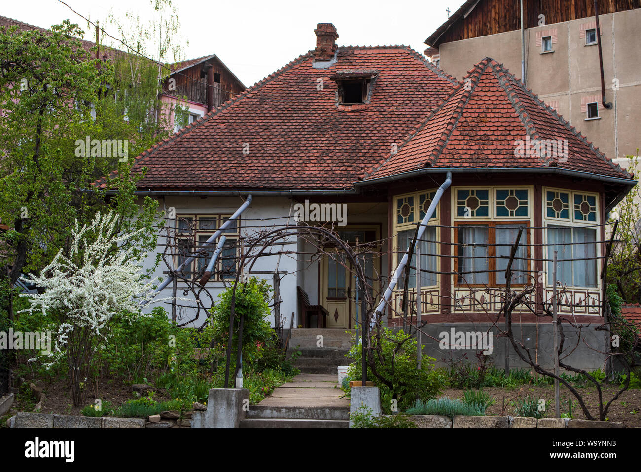 Beautiful Old House With Brick Red Roof Touched By Time And Amazing Windows And Design Stock Photo Alamy
